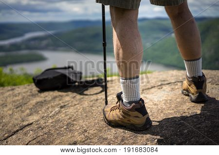 A feet of a hiker standing on the top on the rock near Cold Spring NY