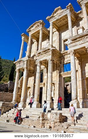 EFES, TURKEY - OCTOBER 1: Roman  Library of Celsus with many tourists on October 1, 2011 in Efes, Turkey.
