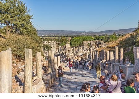 EFES, TURKEY - OCTOBER 1: Curetes Street with many tourists going to see the Celsus Library on October 1, 2011 in Efes, Turkey.