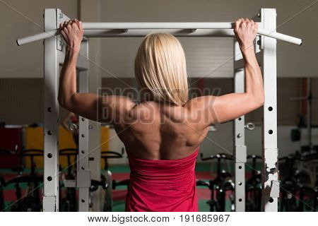 Fitness Woman Doing Exercise For Back On Machine