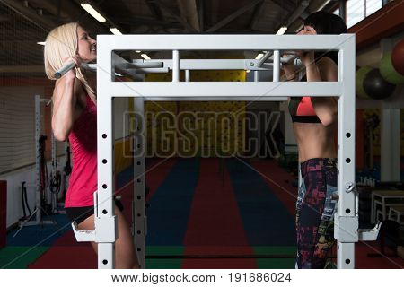 Healthy Young Couple Doing Exercise For Back