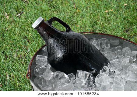 Beer Growler in Ice Bucket on Green Grass