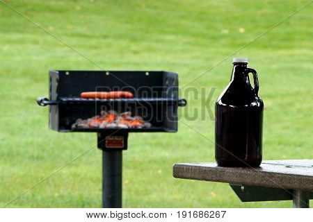 Growler in Front of a Charcoal Grill