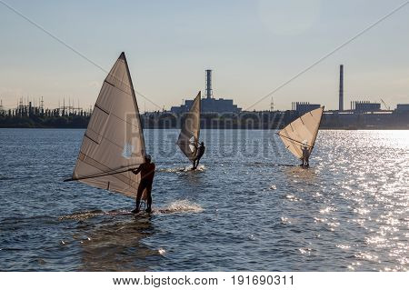 Surfers on background of Kursk Nuclear power plant