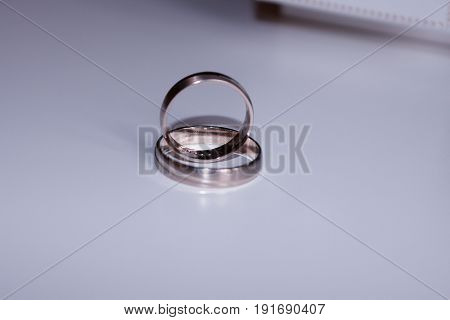 wedding rings isolated on white table .