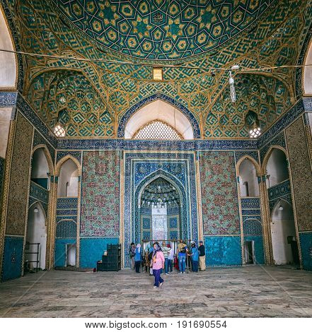 YAZD, IRAN - MAY 5, 2015: Group of tourists visiting the Yame mosque in old city.