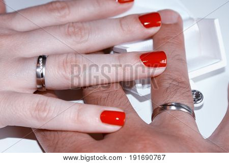 Man and woman with wedding rings on hands