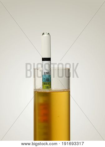 Hydrometer in Homebrew Beer Measuring Alcohol Content