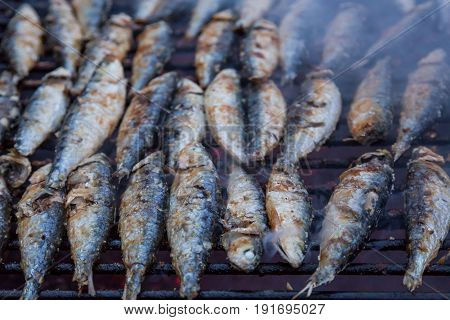 Sardines On Grill On Street Bbq. Hot Tipical Portugal Food