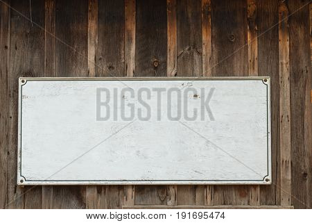 Your text here. Old wooden sign for background.