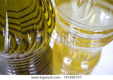 Olive versus sunflower oil bottled in PET. Closeup