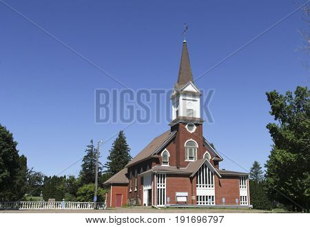 Old country Church against a blue summer sky
