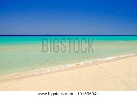 View on the ocean water with beautiful colors on the beach Sotavento on the Canary Island Fuerteventura Spain.