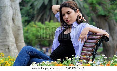 Teenage Female Under Stress Sitting On Bench