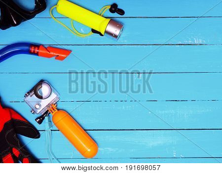 Set for underwater diving to depth on a blue wooden background empty space on the right