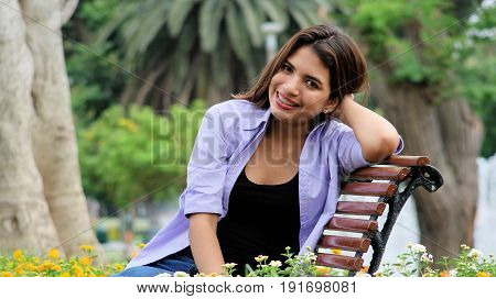 Minority Female And Happiness Sitting In Park