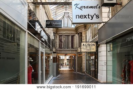 Paris, France-June 17, 2017:The Passage du Caire is the oldest covered arcade in Paris. Situated in the Sentier district, it is almost entirely devoted to ready-to-wear wholesalers