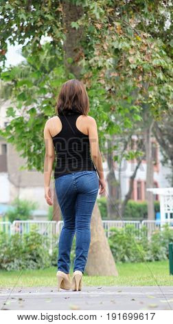 Beautiful Female And Beauty Wearing Blue Jeans Walking In Park