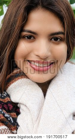 A Portrait of a Latina Female Wearing A Sweater