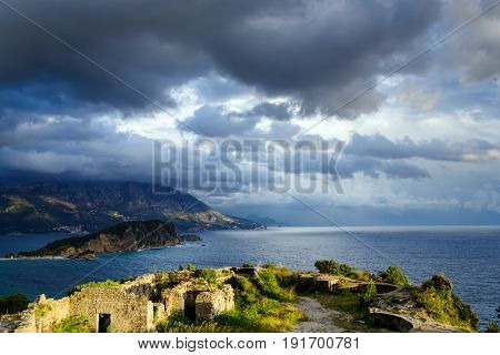Panoramic landscape of Budva riviera from Morgen fortress ruins in Montenegro. Fantastic view of the overcast sky. Balkans, Adriatic sea, Europe. View from the top of the mountain
