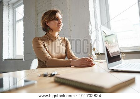 Pretty girl in stylish dress came to the interview for a new job. Woman answer for the interviewer questions. Student discuss salary with employer. Concept of HR department.