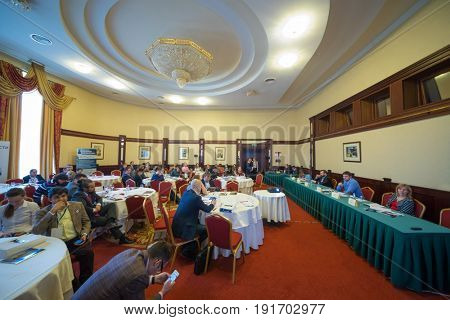 MOSCOW - APR 20, 2017: People sit at tables at practical business conference Second breath of real estate market in Moscow business club in Congress-park Volynskoe