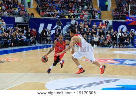 MOSCOW - APR 7, 2017: Two players run at basketball game Euroleague CSKA Moscow (Russia) - Olympiakos (Greece) in Megasport stadium