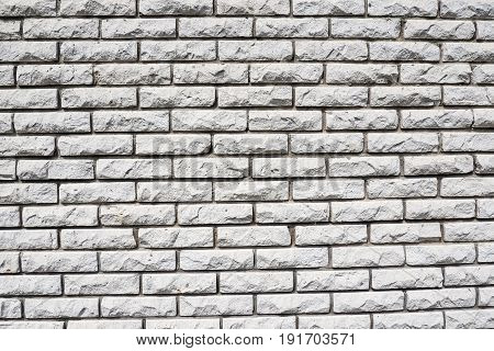 The texture of wall white bricks - background construction of the walls of the building.
