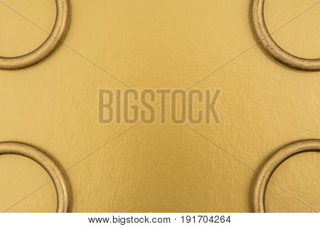 Metal Rings On A Golden Background