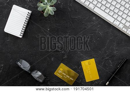 accountant or banker desk with calculator, keyboard and notebook on dark background top view mockup