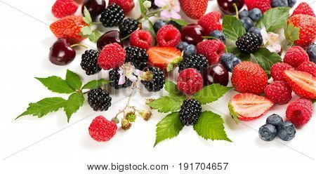 Summer berries and fruits (strawberry raspberry blueberry blackberry and cherry) with flowers and leaves isolated on white background.