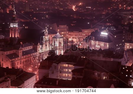 Twilight view of western european city Lviv, architecture background in violet colors