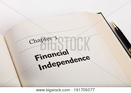 chapter one in an open book with a pen financial independence fake book.