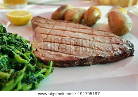 Tuna Steak With Batatas A Murro And Broccoli