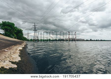 Power electricity station or factory with pipes on a river In Voronezh, view from the reservoir