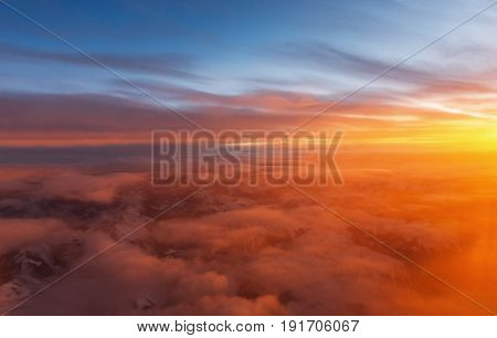 sunset viewed from an airplane over Canadian Rocky Mountains