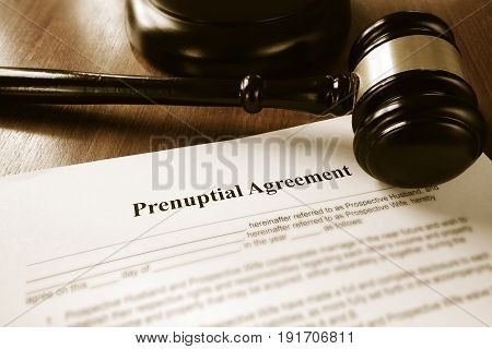 Prenuptial contract agreement and a court gavel