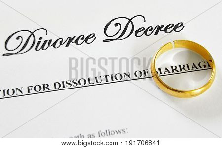 cracked gold wedding ring on a divorce decree