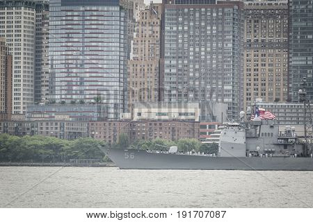 USS San Jacinto (CG 56) passes Lower Manhattan WTC Financial District on the Hudson River during the Parade of Ships at the start of Fleet Week New York, JERSEY CITY NJ MAY 24 2017.