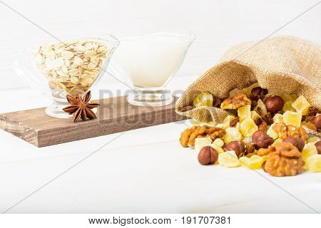 Ingredients With Dried Fruits, Oat Flakes And Milk