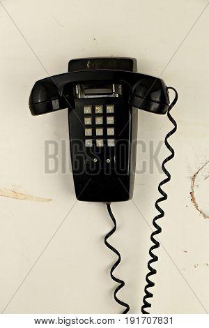 Retro Grungy Analog Phone on Old Paneling