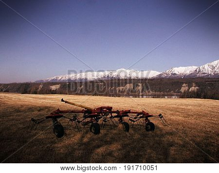 Tedder In A Hay Field With Vintage Effects