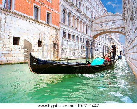 Traditional Gondolas passing over Bridge of Sighs in Venice, Italy
