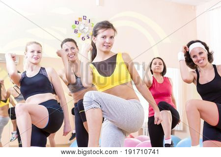 Sport and Fitness Concepts and Ideas. Group of Five Caucasian Female Athletes Having Stretching Exercises in Gym Together.Horizontal Image Composition