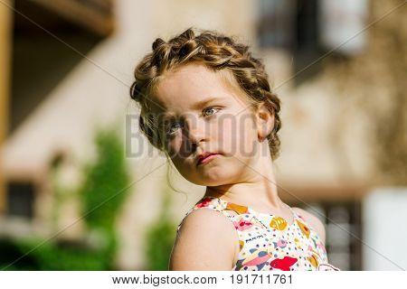 Cute Little Preschooler Girl Natural Portrait On The Sun