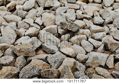 Naturally polished white rock stone pebbles background
