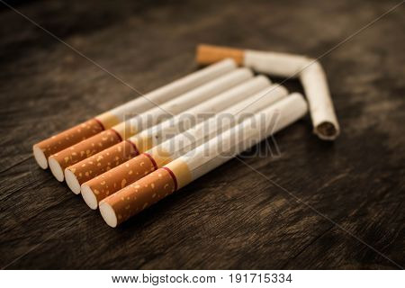 Money to buy cigarettes can build a home Concept stop smoking.