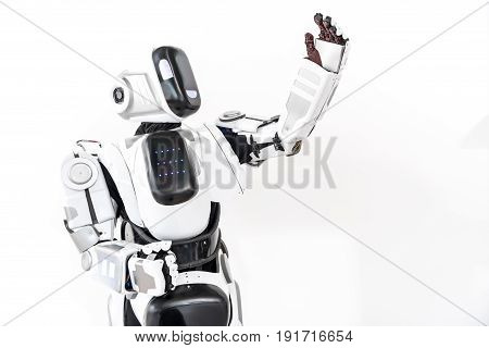 Hello, everyone. Robot is standing and rising hand up. He showing human like palm. Isolated and copy space