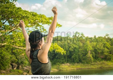 Young women was glad running she reached the destination.
