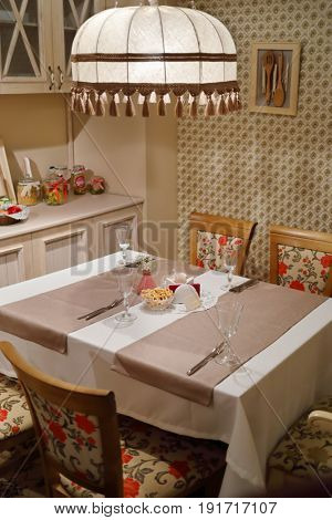 Serving on table with tablecloth in home-style restaurant with lampshade